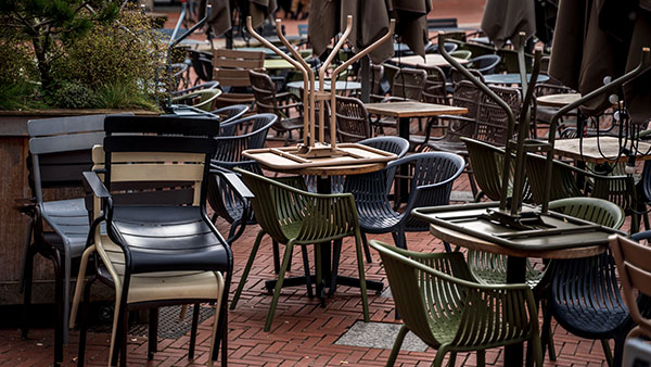 Empty chairs and tables on a patio